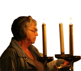 Babs reading by candlelight